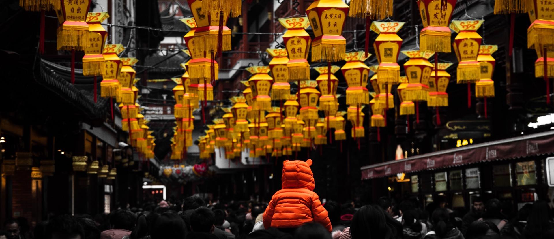 Child and lanterns