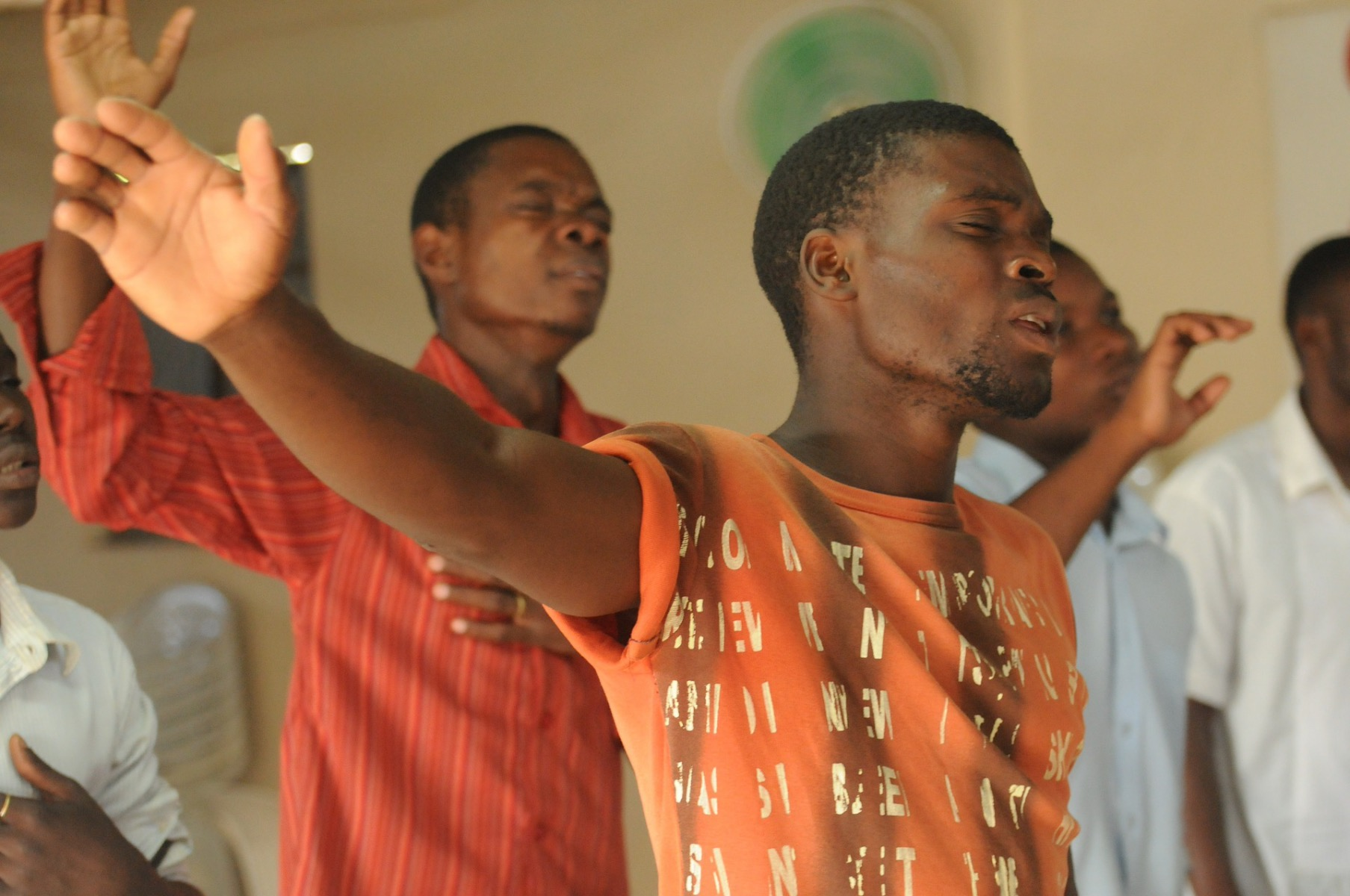 Man in church with raised hand
